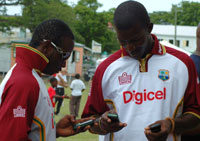 West Indies Cricketers, Xavier Marshall and Darren Sammy using their new Sony Ericsson K850i on Thursday in Antigua on the 2nd Digicel Test
